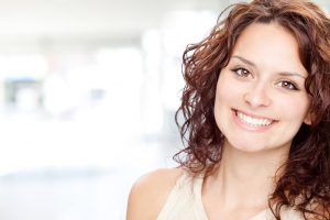 beautiful brunette girl showing results of teeth whitening